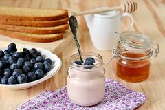 Breakfast with blueberries, honey and yogurt. For healthy lifestyle royalty free stock photography