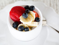 Breakfast of blueberries strawberries banana Stock Images