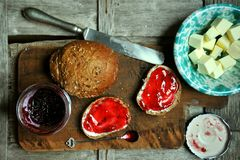 Breakfast with blueberry jam, butter and bread Royalty Free Stock Image