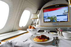 Breakfast on board of Emirates Airbus A380. DUBAI, UAE - MARCH 31, 2015: Emirates Airbus A380 interior. Emirates is one of two flag carriers of the United Arab Royalty Free Stock Photos
