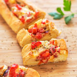 Breakfast Boat with Cheese, Bacon & Tomatoes. Easy peasy and fun way to prepare your breakfast or brunch Royalty Free Stock Photo