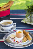 Breakfast of boiled egg, coffee and pastries Stock Photography