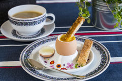 Breakfast of boiled egg, coffee and pastries Royalty Free Stock Photography