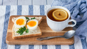 Breakfast with boiled eggs and crispy toasts, closeup Royalty Free Stock Image