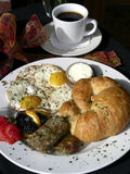 Breakfast With a Bow. Festive colorful breakfast at an outdoor French cafe Royalty Free Stock Images