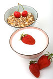 Breakfast, Bowl of cereal and milk with fruits. Breakfast, two bowls once of cereal and once of milk, with red fruits stock photo
