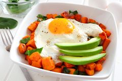 Breakfast bowl close up with sweet potato, egg, avocado and spinach Stock Images