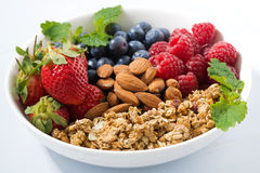 Breakfast bowl with fresh berries, granola and almond, closeup. Horizontal Stock Images