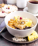 Breakfast bowl with Muesli Oat flakes Berry Raisins and orange Royalty Free Stock Photography