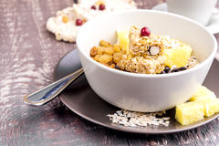 Breakfast bowl with Muesli Oat flakes Berry Raisins and orange Stock Image