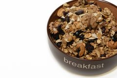 Breakfast: Bowl of whole grain muesli isolated on white background stock photos