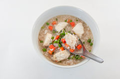 Breakfast with bowl of wild and brown rice soup with fish Stock Photo