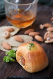 breakfast bread with Almonds and walnuts , and tea or orange juice. on wooden background. selective focus. stock photo