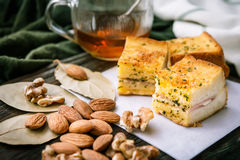 breakfast bread with Almonds and walnuts , and tea or orange juice. on wooden background.selective focus. royalty free stock photography