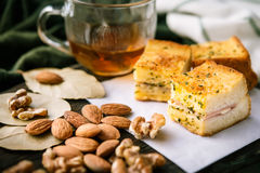 breakfast bread with Almonds and walnuts , and tea or orange juice. on wooden background.selective focus. stock photo