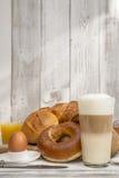 Breakfast with bread, buns, egg, Latte macchiato, orange juice Stock Photo