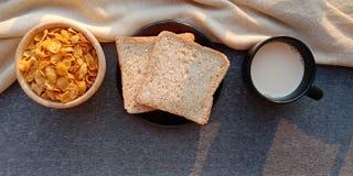 Breakfast : bread,cereal and milk on dark background. stock photos