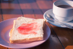 Breakfast bread and coffee Stock Images