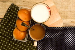 Breakfast with bread coffee and milk on table background. Stock Photo