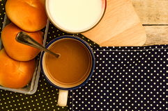 Breakfast with bread coffee and milk on table background. Royalty Free Stock Images