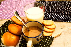 Breakfast with bread coffee and milk on table background. Royalty Free Stock Photos