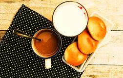 Breakfast with bread coffee and milk on table background. Royalty Free Stock Photography
