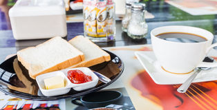 Breakfast. Bread jam with black coffee in morning time Stock Photography