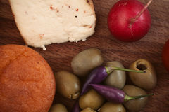 Breakfast with bread, radish, olives and cheese. Stock Photography