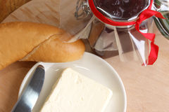 Breakfast with bread roll Stock Images