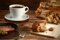 Breakfast with bread , a snack and a cup of coffee.  royalty free stock photos