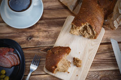 Breakfast with bread , a snack and a cup of coffee.  stock photography