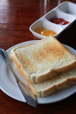 Breakfast bread. On a table Royalty Free Stock Image