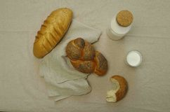 Breakfast with breads and milk Stock Images
