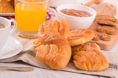 Breakfast with brioches. Breakfast with brioches on wooden table Stock Photo