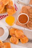 Breakfast with brioches. Breakfast with brioches on wooden table Stock Image