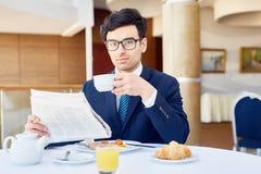 Breakfast of broker Royalty Free Stock Image
