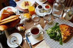 Breakfast or brunch with tea, coffee, juice, eggs and pastry Stock Photography