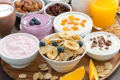 Breakfast buffet with cereals, yoghurt and fruit on wooden tray Stock Image