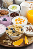 Breakfast buffet with cereals, yoghurt and fruit on wooden tray Royalty Free Stock Images
