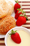 Breakfast with buns and strawberry Stock Photography