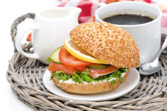 Breakfast - burger with smoked salmon, vegetables and coffee Stock Images