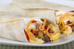 Breakfast Burrito. Two breakfast burritos with sausage, egg and cheese Stock Photography