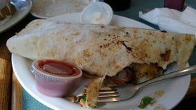 Breakfast burrito food tortilla restaurant salsa sour cream. A picture for any menu, serving delish food Stock Photos