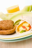 Breakfast Burrito Served with Honeydew Melon Toast and Juice Royalty Free Stock Photography
