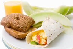 Breakfast Burrito Served with Honeydew Melon Toast and Orange J Royalty Free Stock Images