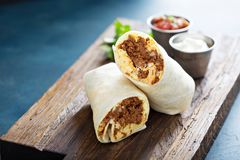Breakfast burrito with chorizo and egg. Breakfast burrito with spicy chorizo and egg stock photography