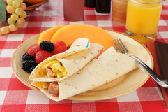 Breakfast burritos with fruit Royalty Free Stock Images