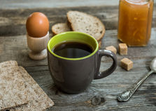 Breakfast business person. Coffee, sheets of notes and stationery on wooden table stock images