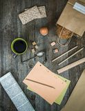 Breakfast business person. Coffee, sheets of notes and stationery on wooden table. top view stock images