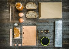 Breakfast business person. Coffee, sheets of notes and stationery on wooden table. top view royalty free stock photography